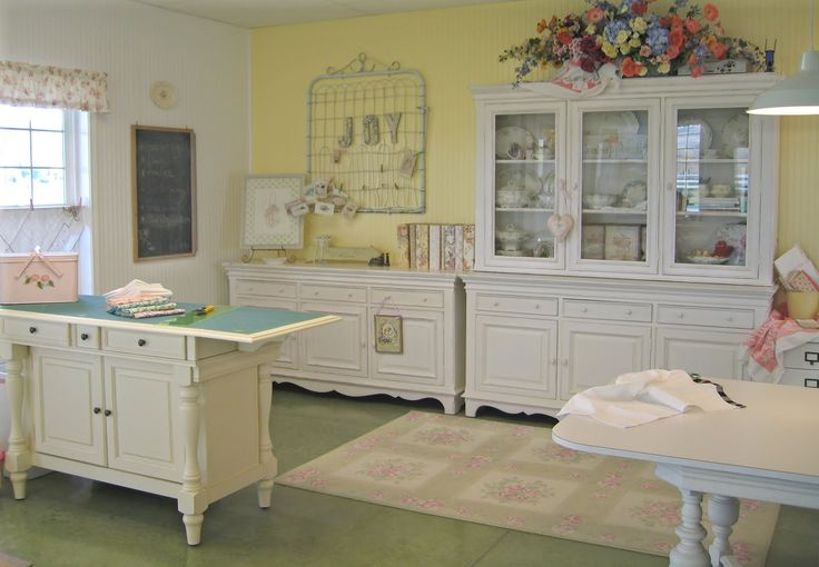 Meg Hawkey's sew/quilt studio.  I love how she used old furniture and repurposed it. Painted white...it all blends together well and doesn't fight the things stored.