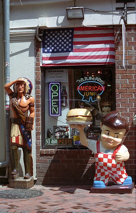 "New Orleans shop. Almost more Americana here than one can stand. Hopefully, the revered Big Boy statue offsets the politically incorrect cigar store Indian. ""The Fine Art Photography of Frank Romeo."""
