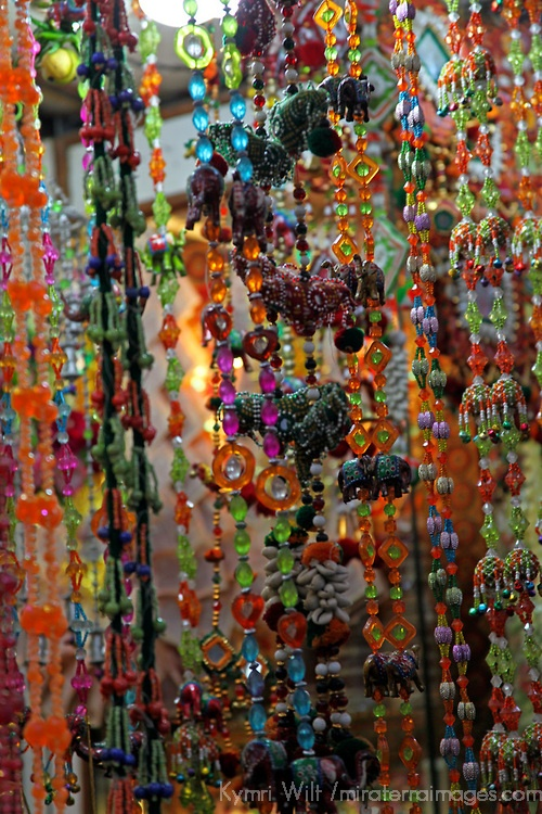 Asia, India, Delhi. Colorful strands of beads hang in market in Old Delhi.