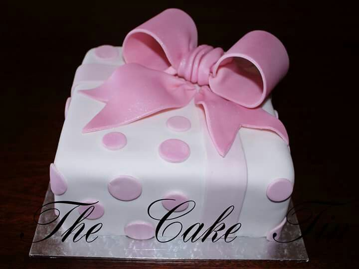 A gift wrapped cake for a teenager