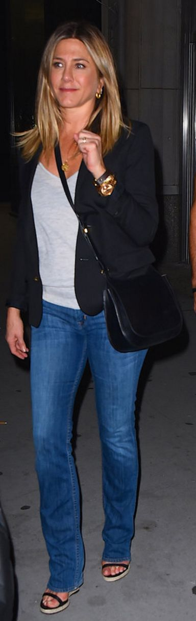 Who made  Jennifer Aniston's black handbag, gold jewelry, watch, and espadrille sandals?