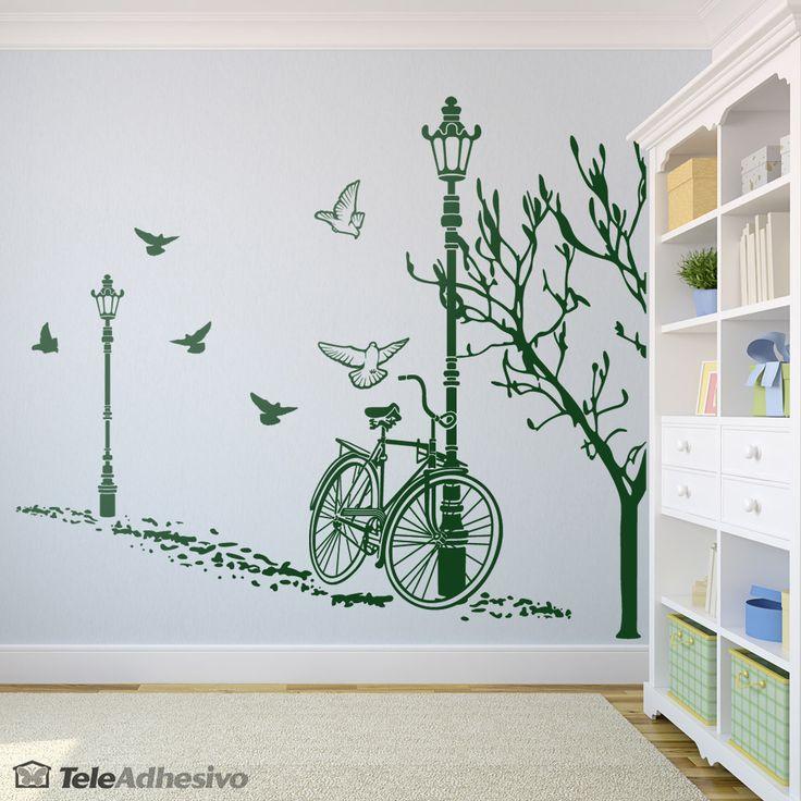 Las bicicletas son para el otoño. Este vinilo decorativo representa un paisaje otoñal en perspectiva de un parque.
