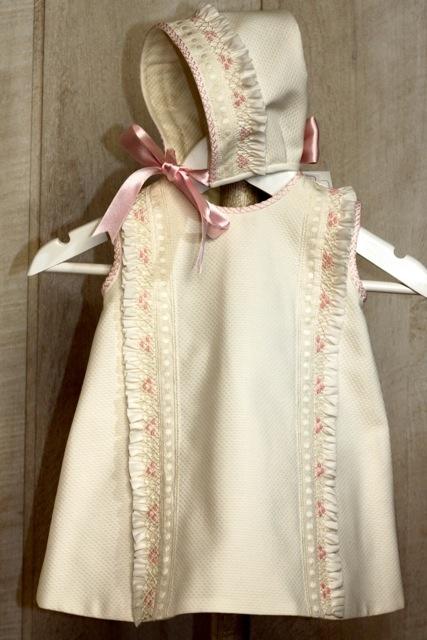 Baby girl dress in beige with flywheel piqué and embroidered pink nest,~~Vestido de bebé niña en piqué beige con volante de nido y bordados en rosa.
