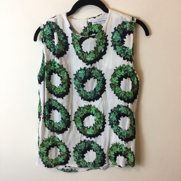 Shop Women's & other stories White Green size 6 Tops at a discounted price at Poshmark. Description: & other stories Top with a white body and a green wreath printed body! Very cute and has buttons in the back and is a size 6.. Sold by marigoldz. Fast delivery, full service customer support.