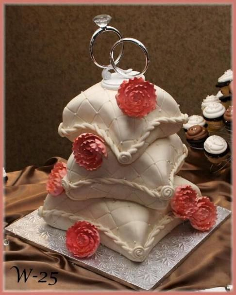 Ivory pillow stacked weeding cake, with quilting and pearls. By Rush City Bakery, Rush City, Mn.