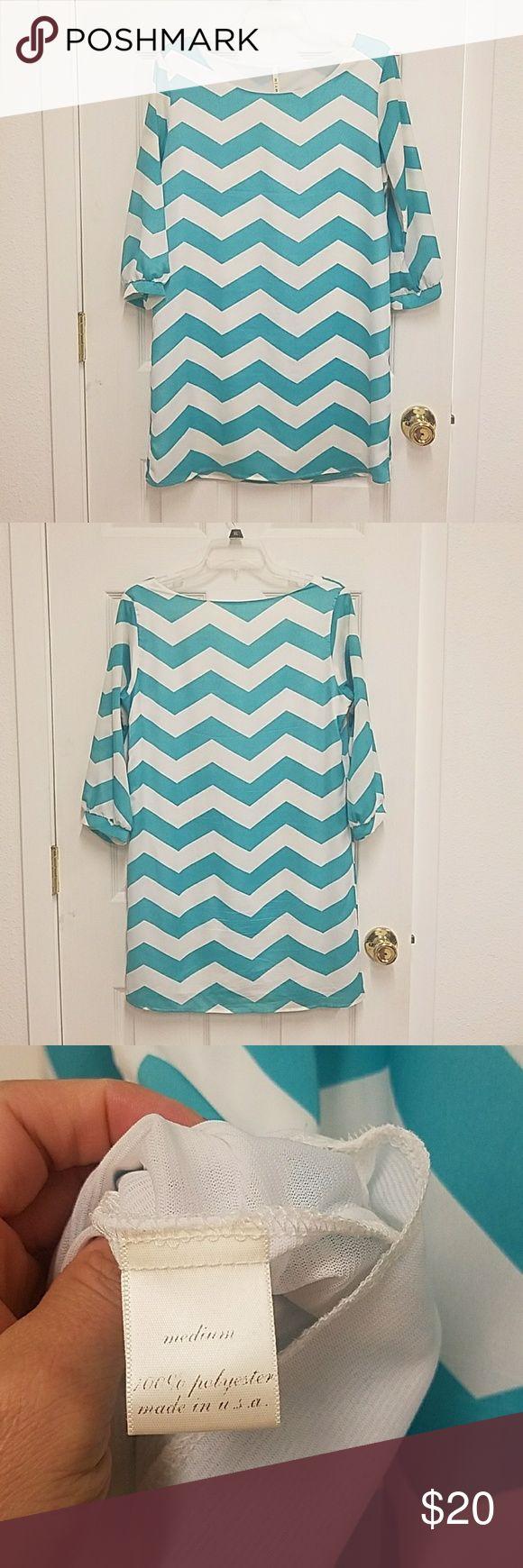 Chevron print dress Tiffany blue chevron print dress.  Super cute. Francesca's Collections Dresses