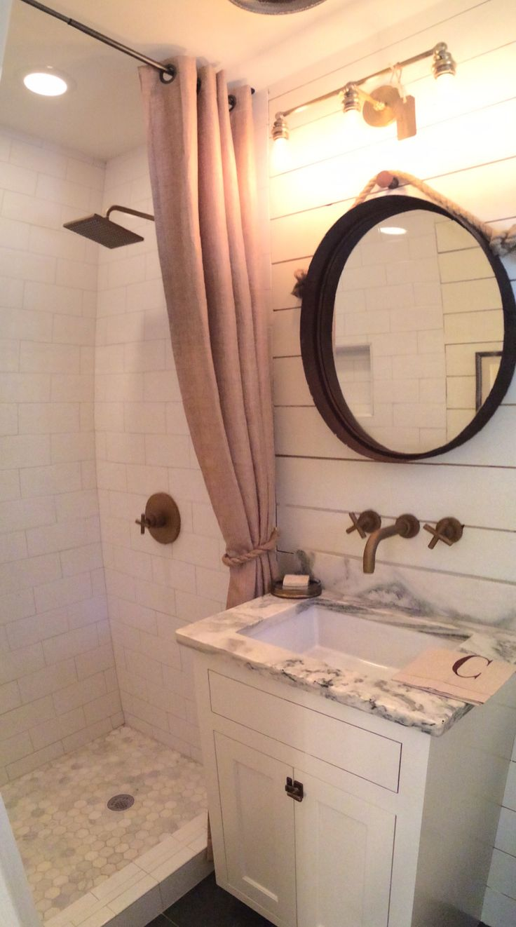 Gorgeous Bathroom With Ship Lap Walls Marble Counter Subway Tiled Shower And Bronzed Fixtures