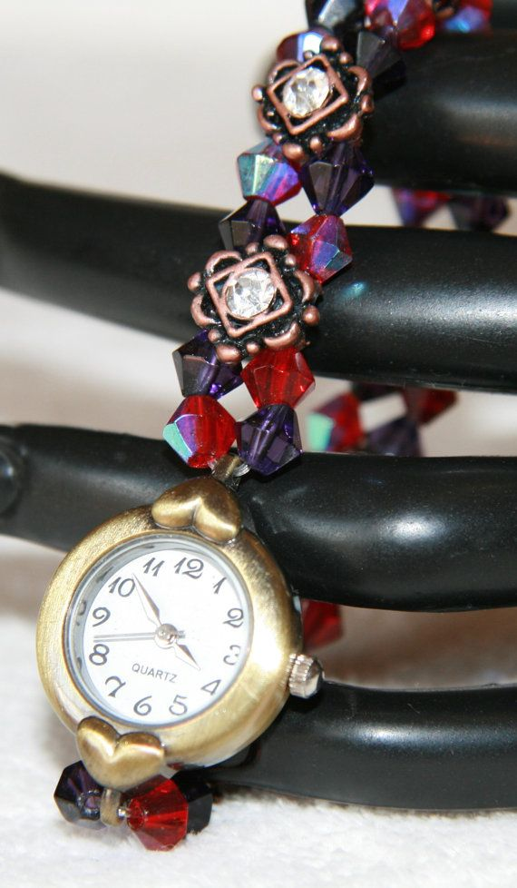 Antique style brass watch with red and purple beads
