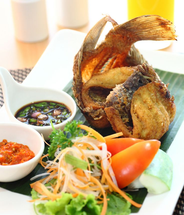 "In the mood for Indonesian cuisine? We have ""Ikan Gurame Goreng"" from Swiss-Belinn Balikpapan  Fish is a good source of protein, vitamins and minerals which are essential to maintain good health"
