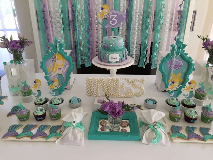 Pretty green and purple dessert table at a mermaid birthday party! See more party ideas at CatchMyParty.com!