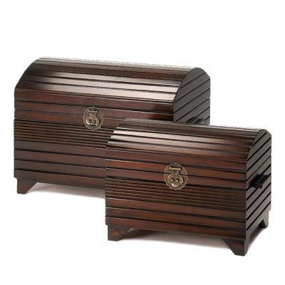 """UPC: #d1139 From formal to casual, this duet of trunks fits faultlessly into your décor! Deep mahogany finish and antiqued bronze hardware complements their classic all wood styling with a feel of worldly sophistication.     Weight 24 lbs.  Large: 24 ½"""" x 16"""" x 16 ½"""" high; small: 19"""" x 12"""" x 12"""" high.   Wood and veneer board.   Set. $175 (plus tax/shipping). - to place an order for this product, contact us at asimpletouchgallery@gmail.com"""