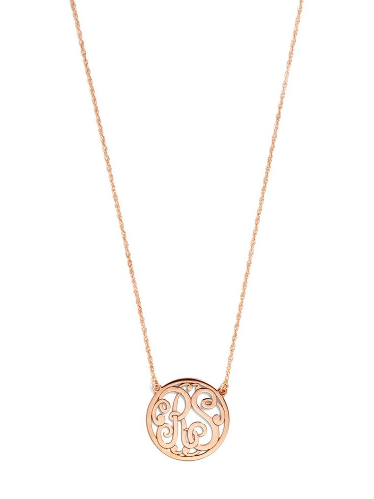 A feminine, scrolling font is neatly encircled in metal for a seal that's uniquely yours. Completely personalize this piece with custom metals, chain lengths and pendant sizes.