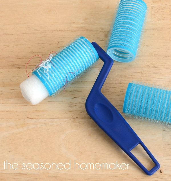Pick up stray threads from sewing projects :: put a fuzzy velcro-type roller over a small paint roller and just roll the threads right up