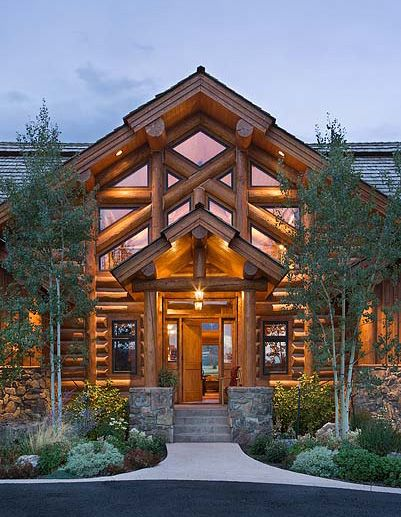 These guys are really doing log homes right!  Could use a carved door though (masterwoodcarver.com).    Log Home by: www.precisioncraft.com/