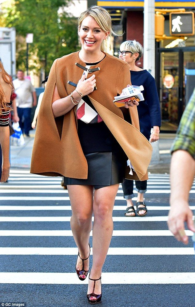 The pin parade:Hilary Duff showcased her lean legs in a black leather mini skirt as she continued to film Younger in New York City on Monday