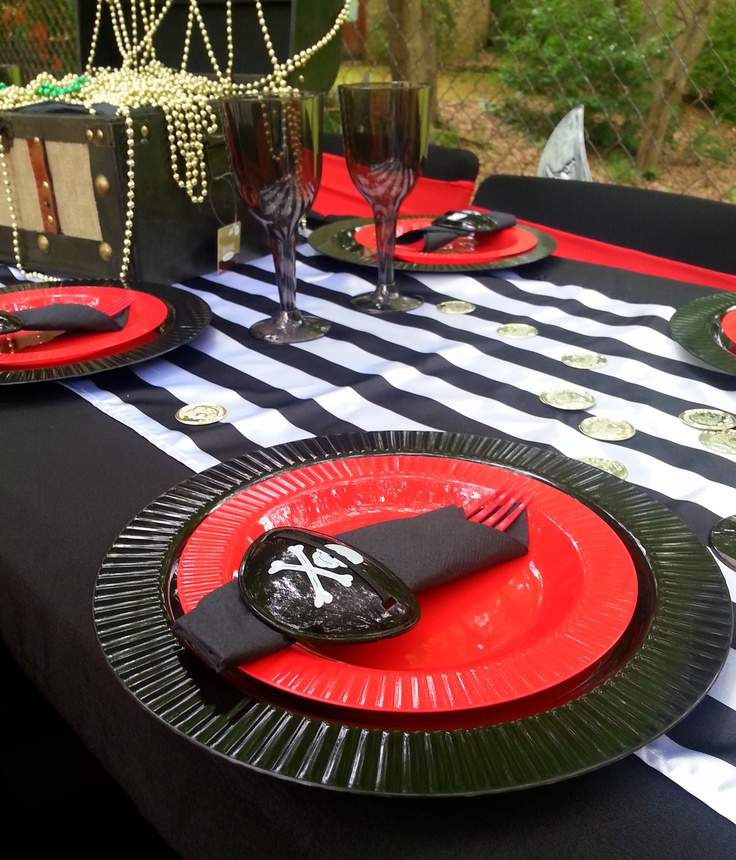 Pirate party place settings include eye patch! Arrr!