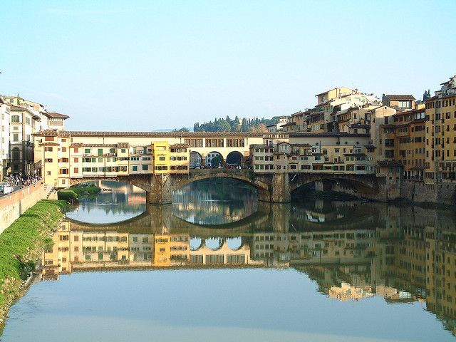 """The Ponte Vecchio (literally """"old bridge"""") is a Medieval bridge over the Arno River in Florence; the only Florentine bridge to survive WW2. The bridge is famous for still having shops built along it, as was common in the days of the Medici.Shops Built, Tourist Attraction, Medieval Bridges, Old Bridge, Florence Italy, Arno Rivers, Vecchio Liter, The Bridges, Vecchio Bridges"""