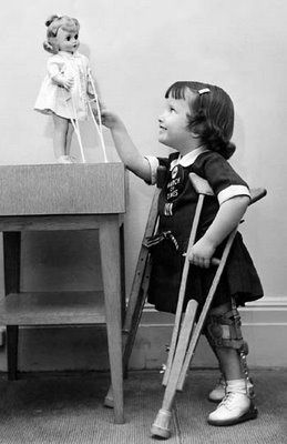 Let's do the best things for children!     A little girl on crutches with her Madame Alexander 'Marybel' doll who came with crutches and hos...