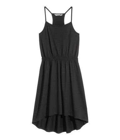Black. CONSCIOUS. Dress in soft jersey made from an organic cotton and modal blend with narrow shoulder straps, a racer back, elasticated waist and rounded