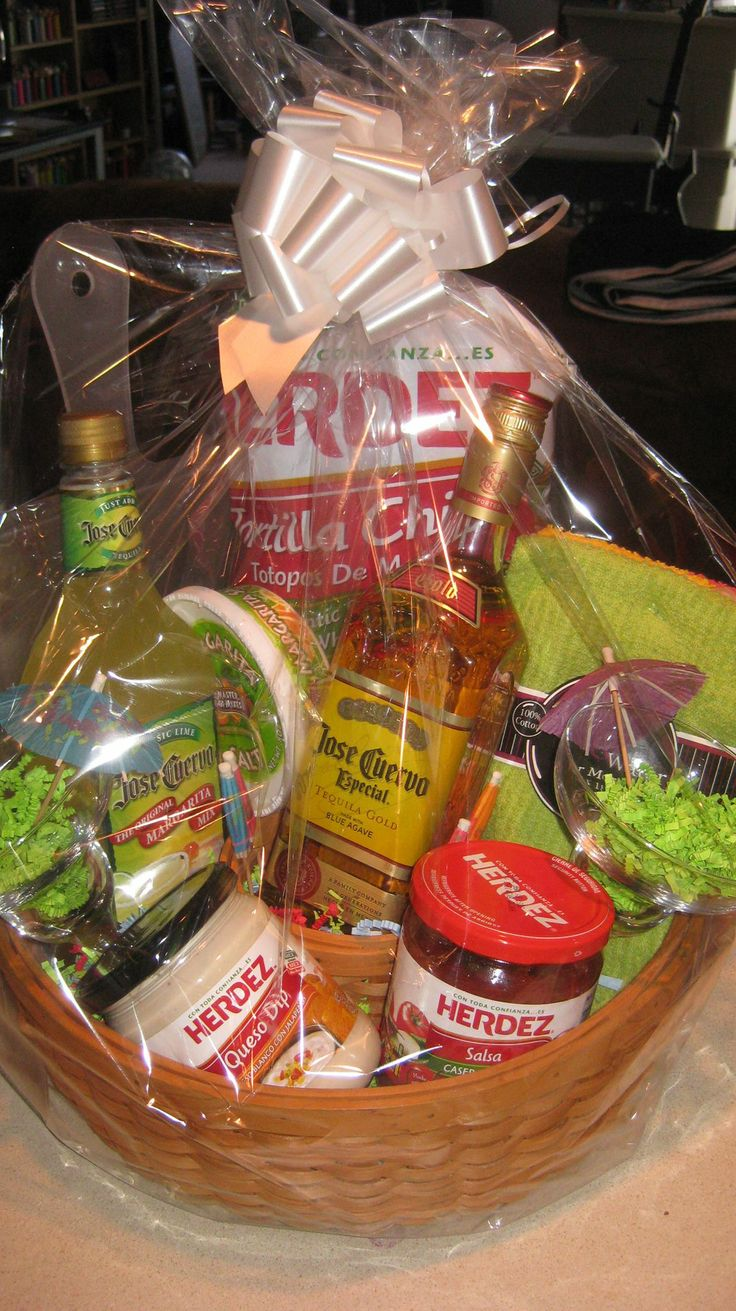Margarita Fiesta basket - - - Made this for a basket raffle fundraiser. Margarita mix, tequila, margarita salt, salsa, queso, tortilla chips, margarita glasses, bar towels all in a chip basket.