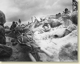 The Bloody Battle of Tarawa, 1943. Marines hunker down at seawall.