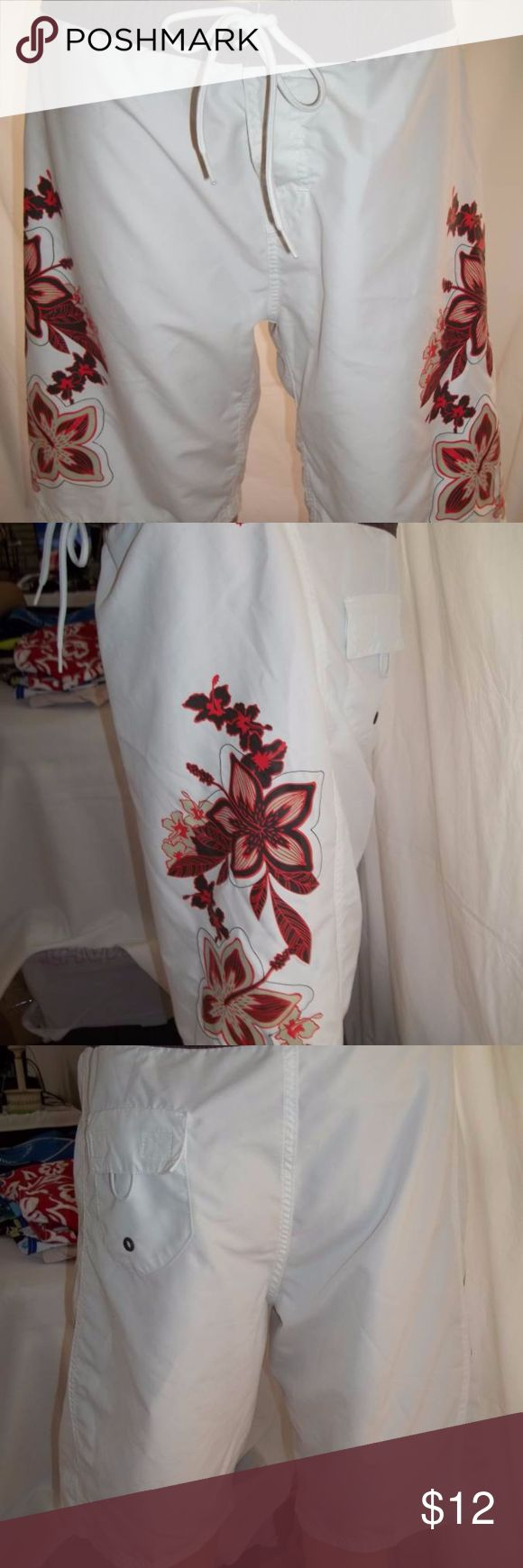"""O'Neill Board Shorts w/Floral Design-GirlsSize: 13 This is a O'Neill Junior Girls Board Shorts. Has a nice floral design on both sides and a velcro closure with ties. Excellent Pre-Owned-Size: 11, Colors: White with Brown/Orange/Green detailing, Measurements: Waist: 34"""" and Inseam: 10"""". One to wear casually to a fun event or when you go to the pool, beach and lake. Thank you for coming to Karens Collectibles closet here on Poshmark. O'Neill Shorts"""