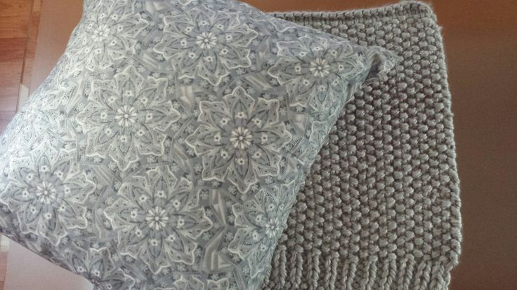 a silver pillow with a silver rug