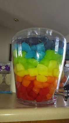 Rainbow punch. Made with Kool-Aid ice cubes and 7 - up. Such a fun party idea!