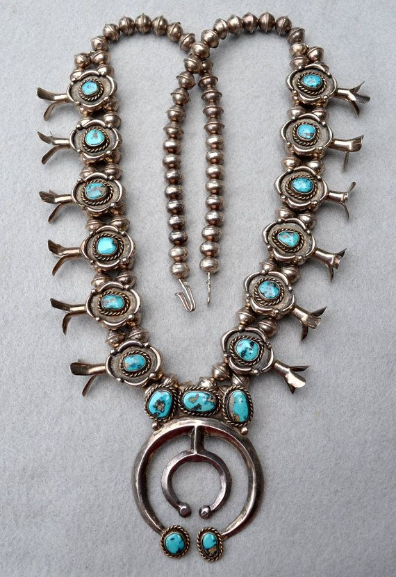 This Navajo Squash Blossom Necklace is from the 50s and a real beauty! About 30 inches of sterling silver beads with a double row behind the