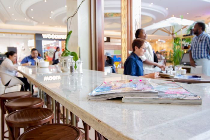 The coffee bar and waiting area at tashas Canal Walk, Cape Town.  This use of granite creates an elegant coffee bar. Visit www.rudischoice.co.za to select your granite and marble surfaces for South Africa and Zimbabwe!