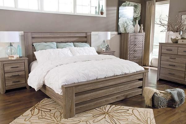 """The true rustic beauty of vintage style has never been brought to life more than with the warm relaxing design of the """"Zelen"""" bedroom collection. The warm gray finish features a stylish white wax effect beautifully complementing the replicated oak grain all surrounding the unique horizontal pocket details and wide pilasters adorning this rustic furniture."""