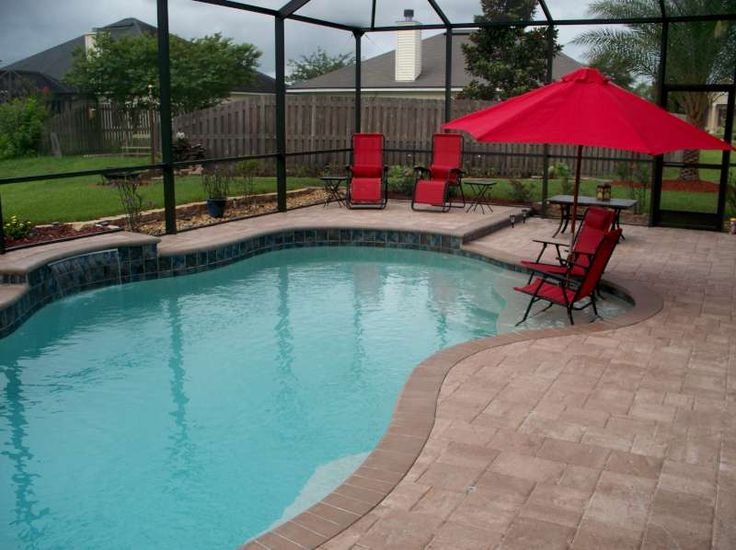 Swimming pools with sun shelves form pool pool for Pool builders jacksonville