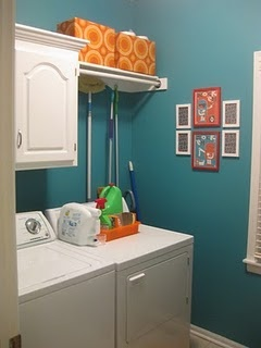 I think I will do this... with another shelf at the bottom of the cabinet! Perfect for my laundry room! =)