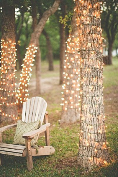 Create a romantic ambience simply by wrapping string lights around the trees at your outdoor wedding.