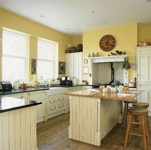 This is the country feel I want for our kitchen, just with wooden cabinets.  Love the yellow walls!