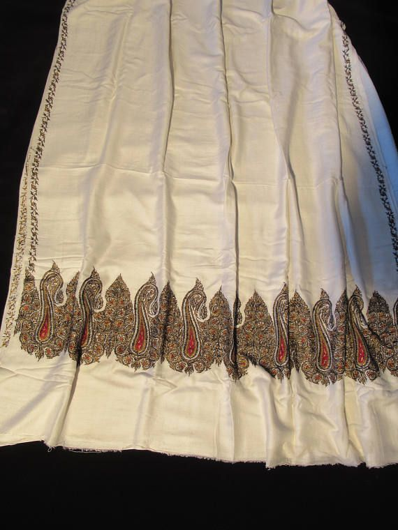 An elegant ivory, silk saree hand embroidered. Never worn. There is a 1/2 in. tear near the border which is hardly distinguishable. It was collected in India during the early 60s.