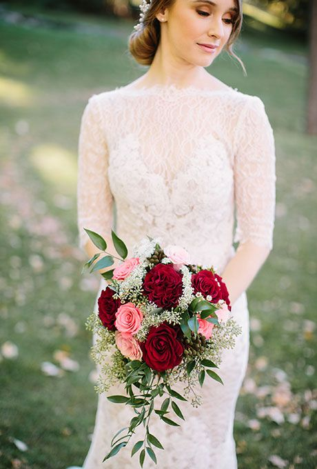 Brides: A Cascading Red Rose Bouquet with Pops of Pink. A mixed bouquet of red garden roses, pink and red roses, baby's breath, and greenery created by Flowers by Janie.