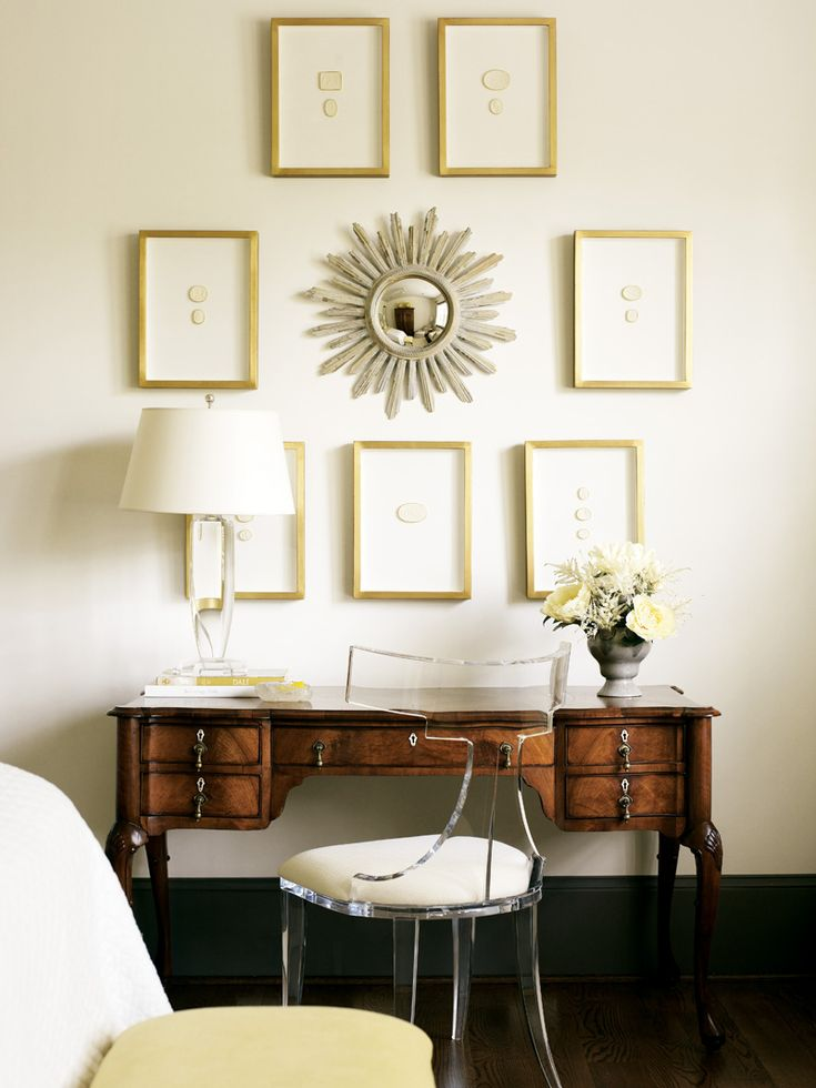 Antique desk, Lucite chair,  and intaglio collection. Atlanta home of designer Alison Womack Jowers.