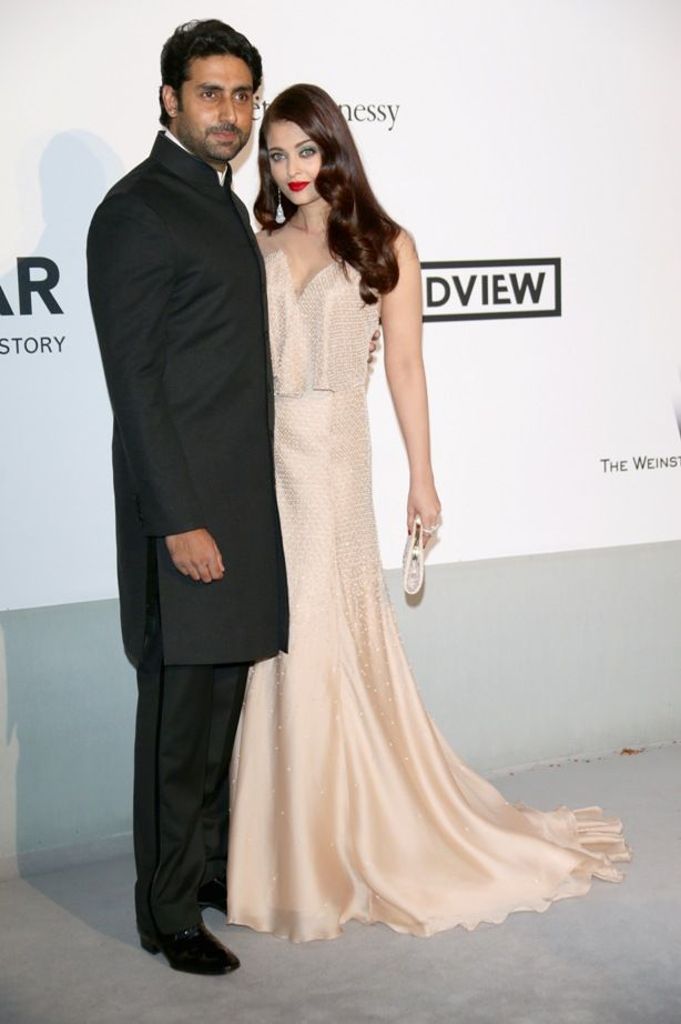 Aishwarya Rai Bachchan joined by Abhishek Bachchan at the annual amFAR gala. #Style #Bollywood #Fashion #Beauty #Cannes2014
