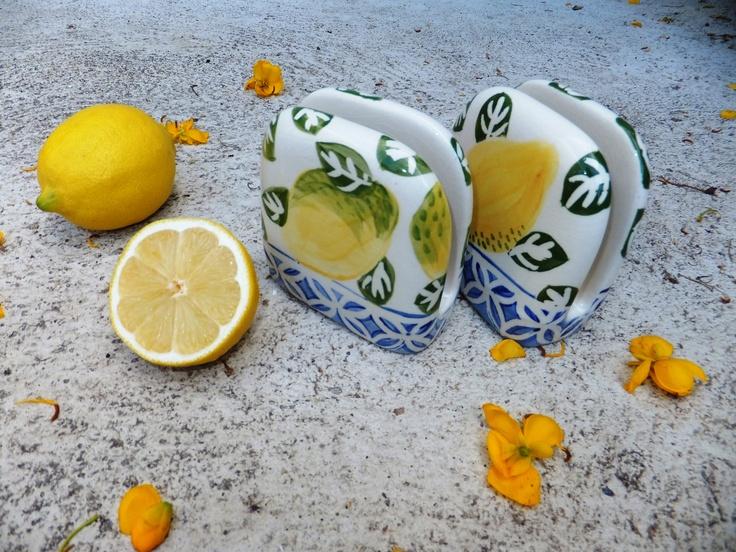 a set of lemon designed serviette holders.