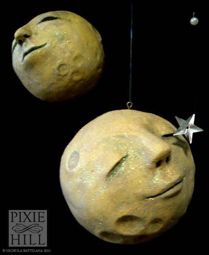 paper clay and styrofoam moon ornaments, going to try to reproduce Georges Méliès' A Trip to the Moon's moon using this.
