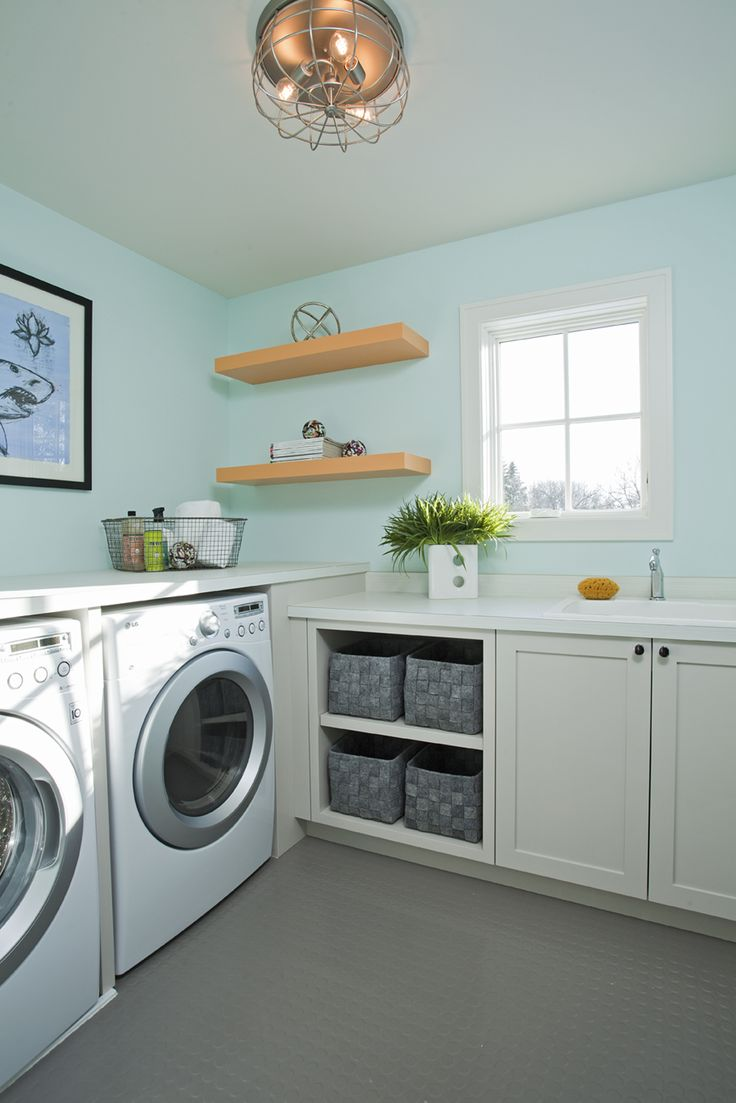 Turquoise Laundry Room Features Walls Painted Turquoise Blue Lined With  Shaker Cabinets And A Laundry Room Sink Next To Open Shelving Filled With  Gray ...