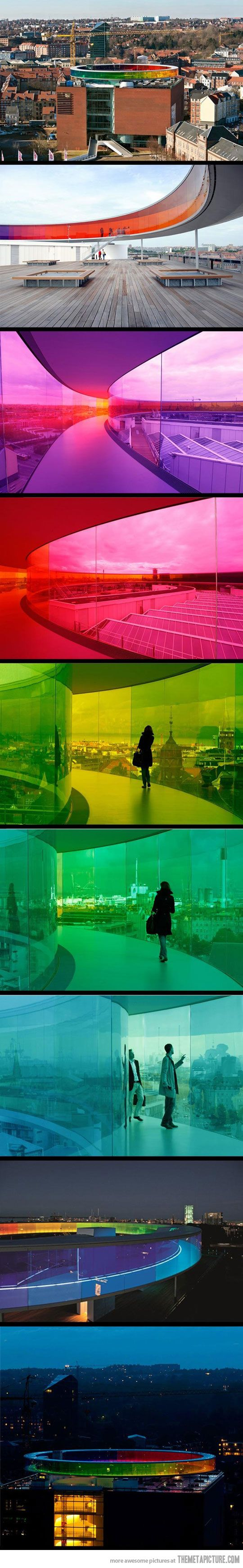 """Olafur Eliasson's, """"Your rainbow panorama,"""" is a circular, panoramic walkway, in all the colors of the rainbow, constructed on the roof of the cubic museum building designed by schmidt hammer lassen. The ARoS building [in Aarhus, Denmark] was inspired by Dante's 'Divine Comedy'..."""" Read more here: http://www.arcspace.com/architects/olafur_eliasson/rainbow-panorama/rainbow-panorama.html"""