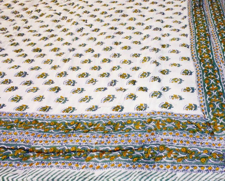 Our green Rajasthani premium rajai is coloured with turmeric and lilac and is handmade in Jaipur, it is priced at AUD$149.95