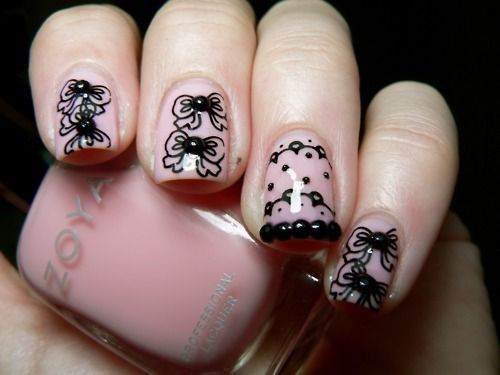 """I currently have black """"lace"""" with a cream background nail stickers on right now...loving them"""