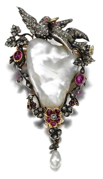 PEARL, RUBY AND DIAMOND BROOCH/PENDANT, LATE 19TH CENTURY Centring on a baroque pearl, framed by a floral and foliate garland surmounted by a pair of doves, set with cabochon and circular-cut rubies and rose-cut diamonds, suspending a pearl drop