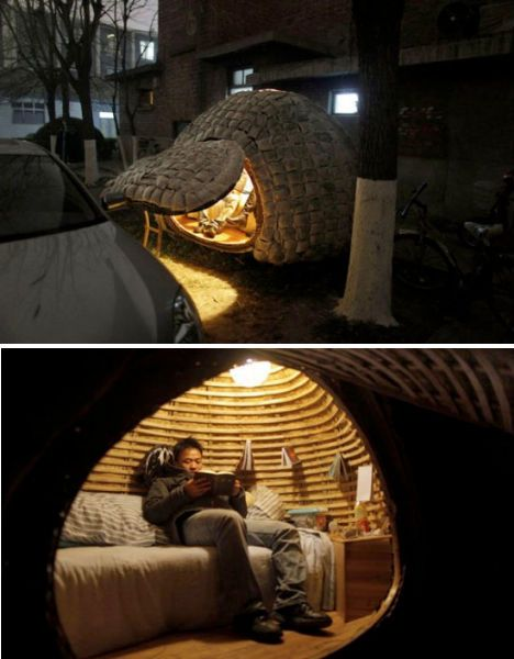 A Chinese student lives in a tiny egg-shaped house made of a bamboo frame and inspired by the grass-covered domes of Norway. Parked right across the street from where owner/builder Daihai Fei works, the Egg House was topped with a layer of stitched bags filled with sawdust and grass seeds, from which the green roof sprouts. This layer provides both protection from the rain and insulation. Inside, Fei has a bed, a small sink, a lamp powered by a solar panel and a bookcase.