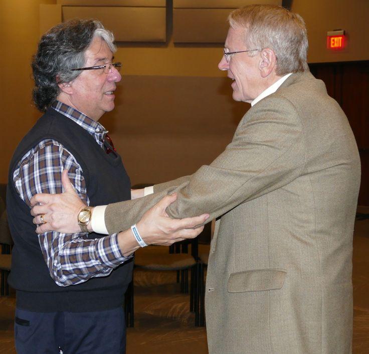 Journalist Frank Valles shares a testimony with PCCNA President Jeff Farmer.