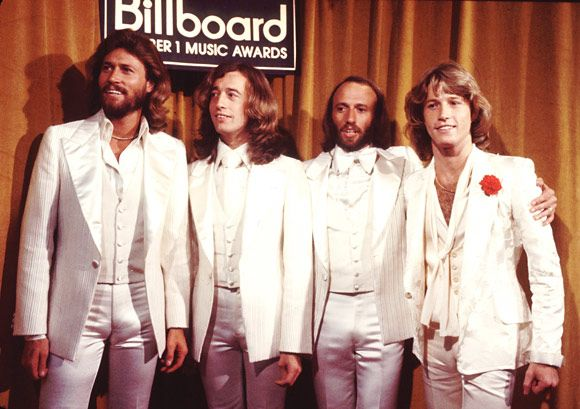 The Brothers Gibb of the Bee Gees showed off winning -- and matching -- style at the a precursor to the Billboard Music Awards in 1977. | 60 Memorable Moments From Past Billboard Music Awards