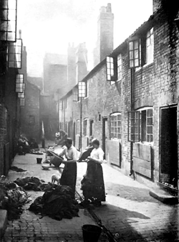 Sorting rags in an East London slum court...